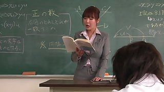 Educator helps a well-draped schoolgirl to try out on the ascription