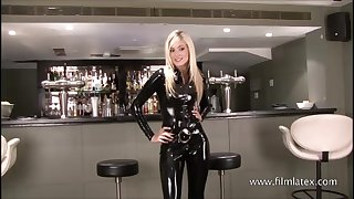 Classy latex barmaid Chritianas high heels and upper case slim