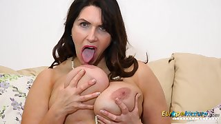 Solo horny mature Josephine out of reach of her sofa masturbates surrounding her vibrating toy