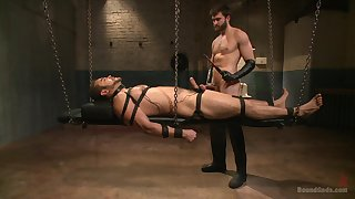 Gay in chains endures male master's dirty lasciviousness