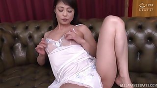 Solo Japanese Ootomo Izumi drops her panties in the air play with a dildo