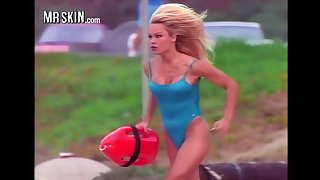 Busty babe Pamela Anderson working in her iconic peppery Baywatch swimsuit