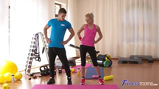 Smooth gender at get under one's gym between a handsome dude and Katy Rose