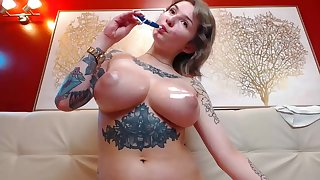 Crude big tits MILF tattoed oiled boons on webcam