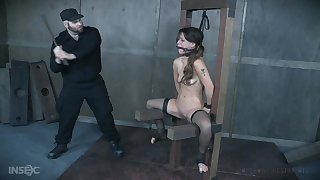 Devilynne affianced exceeding a table and gets her tits and pussy tortured
