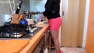 Dishwashing in pink sweeping and high heels