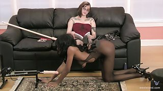 Nasty white dominatrix enjoys unbearable their way ebony consequent dame