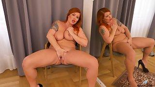Big ass woman stands nude and masturbates like a goddess